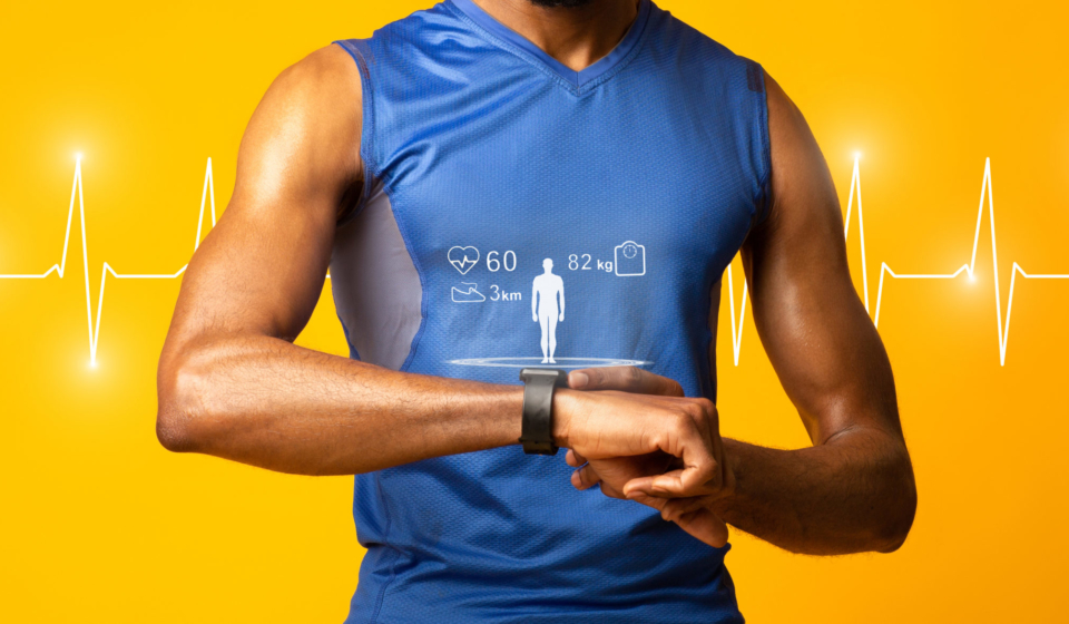 Fit Concept. Black muscular man checking fitness tracker, yellow studio wall, panorama, heart beat line in the background
